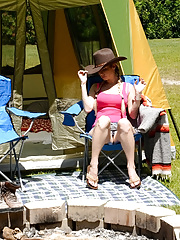 MILF in a pink top and denim bottoms gets naked to boink at campground