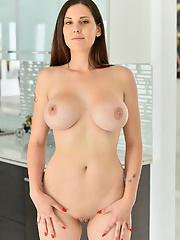 MILF Lilian Stone teases with her big boobs in kitchen