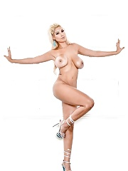 MILF mom Bridgette B stripping off her blue bikini