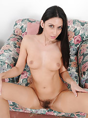Nikki Daniels in red lingerie showing off a hairy pussy