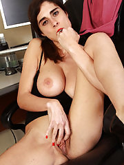 Office assistant Abbey spreading wide in her office chair