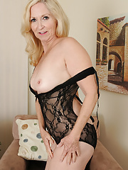 Old aged mature blonde Annabelle looking sexy in her black lingerie