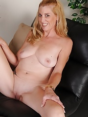 Older blond Liz Summers naked in only white heels
