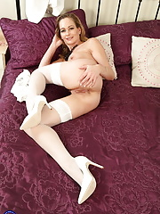 Older blonde in white lingerie posing naked and inserting sex toy