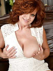 Older woman Andi James shows us her hairy vulva wide open after disrobing