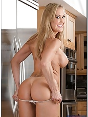 Older woman Brandi Love  taking a cock and blowing in kitchen