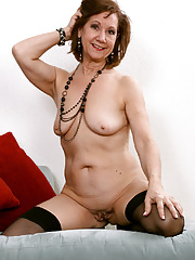 Older women in heels unclothing lingerie and spreads her pussy
