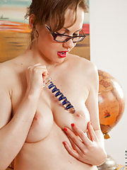 Perfect tittied milf slides a glass dildo into her puffy twat