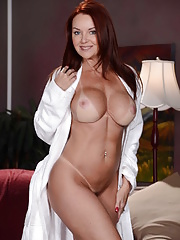 Pornstar Janet Mason with Tan lined tits posing and striping before massage