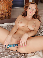Red headed hotty Jessica Red stuffing her shaven box with a blue toy