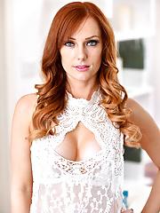Redhead Dani Jensen bares her big natural mature tits in white lingerie