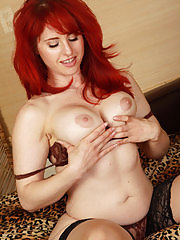 Redheaded Andrea Rosu slips out of her tight lingerie