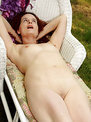 Redheaded Gloria M takes it all off and spreads outdoors