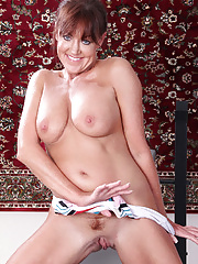 Redheaded Shauna works out her arms and her pussy