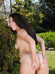 Sexy brunette MILF Stacey Sinns spreads her round ass outdoors