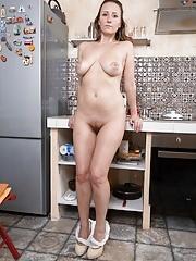 Splendid amateur wife exposing her hairy snatch in kitchen
