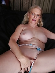 Stunning grandma displays her flabby saggy juggs in lace lingerie