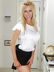 Stunning mature cougar Pamela Rivett exposes big fake tits