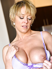 Tattooed Dee Williams with her big tits exposed