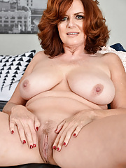 Thick fatty mature redhead showing off her massive BBW tits