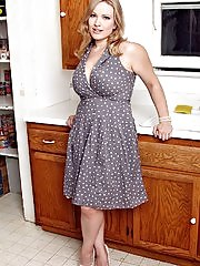 Thick MILF Vicky Vixen strips naked in the kitchen