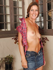 Thin LA Valkenberg slips out of her short denim miniskirt