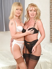 Two mature milfs playing with eachother