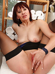 Vera Delight spreads her mature stocking covered legs